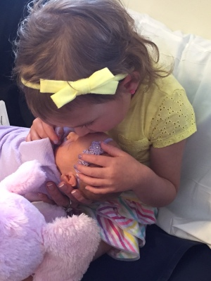 Kisses from our big cousin Ella!