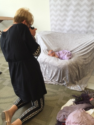 "So much fun at our newborn photo session with Christy Lee. Can't wait to see the ""professional"" photos!!"