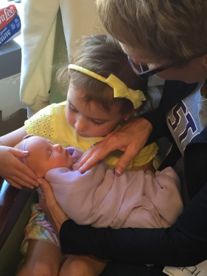The very first time my eldest niece got to hold my eldest daughter. Theirs is a relationship I will always treasure. And the relationship she never got to have with Emmy is one I will always mourn.