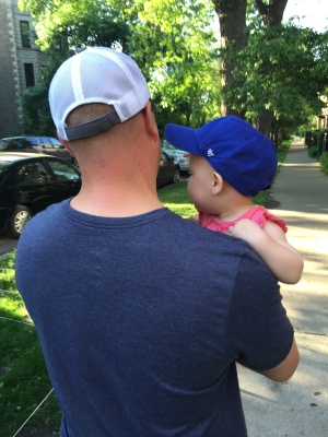 Walking with daddy after your first Cubs game.